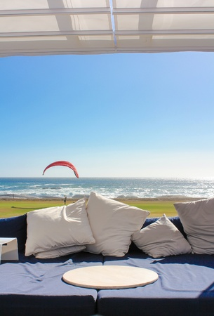 Beach club couch with ocean in the background Stock Photo - 15635948