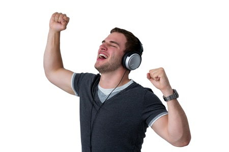 Young Man Listening to music and dancing with arms in air Stock Photo - 15867747