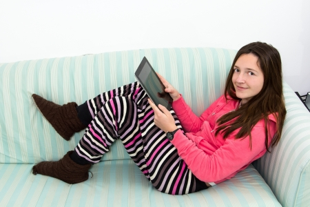 in pajama: Brunette Teenage Girl Working On A Table PC Stock Photo