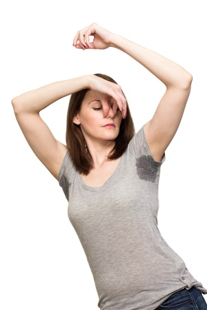 armpit hair: Woman sweating very badly under armpit and holding nose