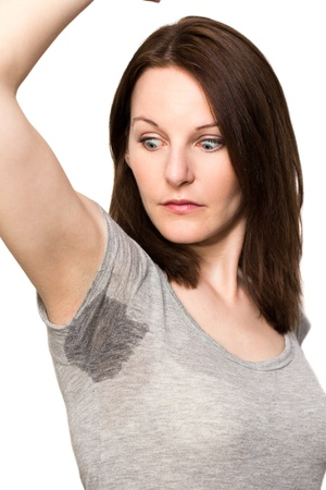 Woman sweating very badly under armpit photo