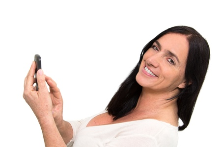 Dark haired woman using touchscreen of a Smartphone photo