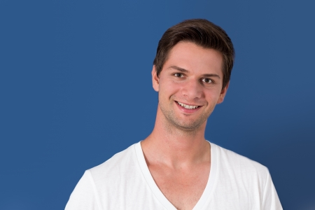Portrait of a young man in front of a blue background Stock Photo - 19089196