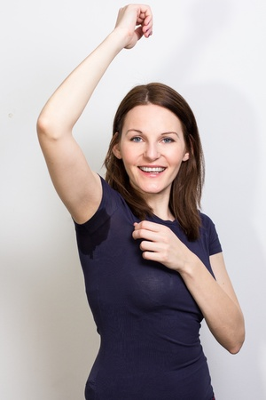 badly: Woman sweating very badly under armpit