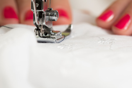 seamstress: using a sewing machine and showing the sewing process
