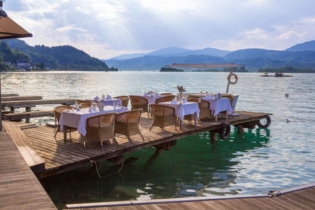 Luxurious restaurant with tables on pier at a Lake in Austria Stock Photo - 24075346