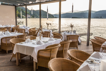 Luxurious restaurant with tables on pier at a Lake in Austria Stock Photo - 24075347