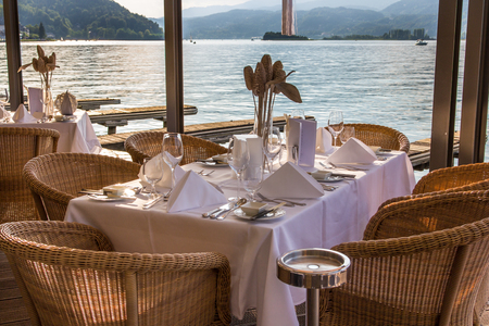 Luxurious restaurant with tables on pier at a Lake in Austria Stock Photo - 24075350
