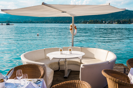 Luxurious restaurant with tables on pier at a Lake in Austria Stock Photo - 24075351