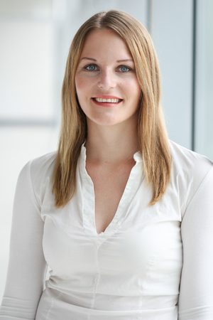 Businesswoman standing in a modern Building with a white shirt photo