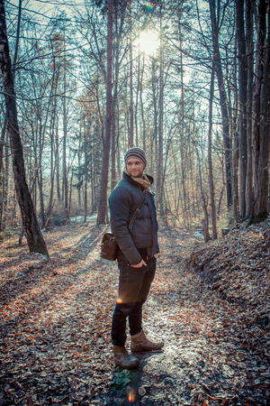 Man standing in the forest photo