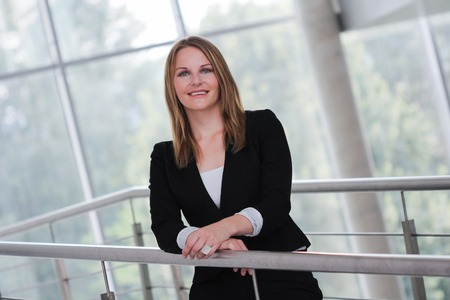 Businesswoman with a black jacket and black pants photo