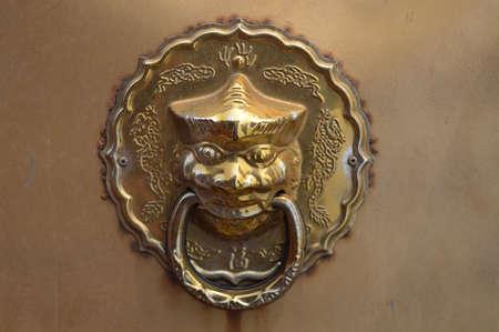 銅のドアノッカー 写真素材