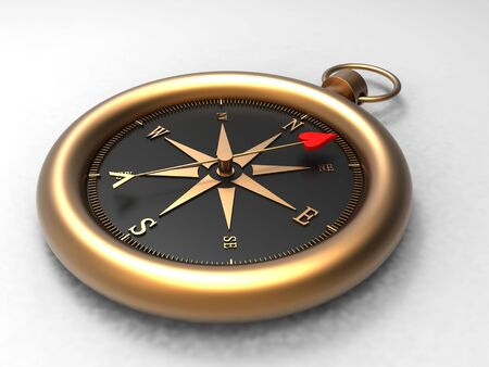 A compass with a heart as an arrow showing the right direction to go Stock Photo