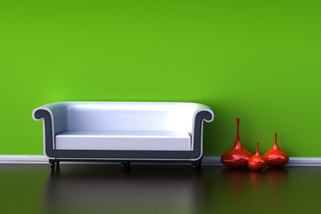 Interior with a green wall and a black sofa