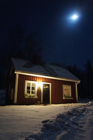 Swedish red Cabin during night fall Stock Photo