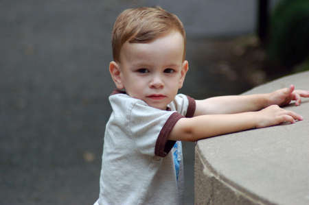 Little Boy Leaning on Wall