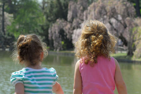 Little Girls Looking at Water