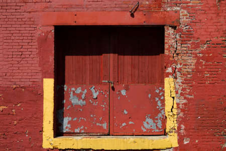 A background photo of a red factory door Stock Photo