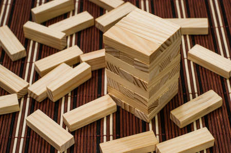 spread around: Wooden blocks tower and block spread around
