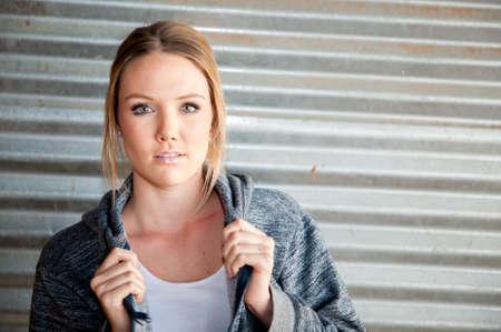 hooded sweatshirt: Twenty something sportyfemale model wearing a hooded sweatshirt Stock Photo