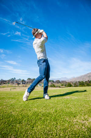 par: Close up image of a male golfer playing a shot on the fairway on a golf course in south africa Stock Photo