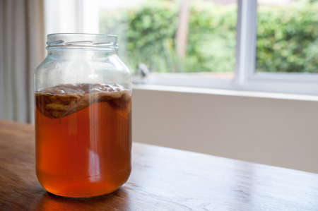 Kombucha tea, the brew is ready to be placed in storage with the bacteria culture in place to ferment the brew. Stockfoto