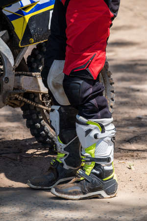 close up image the lower half of a rider and their motorcross bike