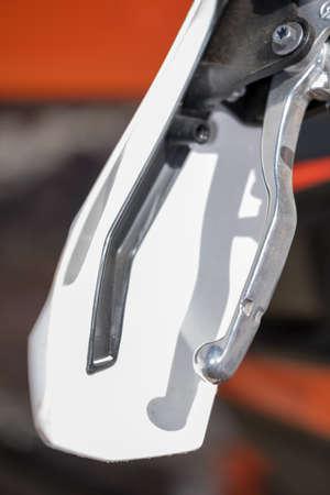 close up vibrant image of a motor bikes brake lever