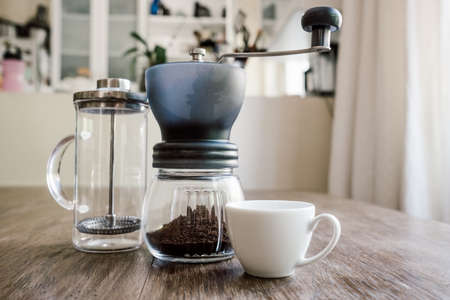 plunger filter coffee being prepared at home on a vintage jug with white cup Stock fotó