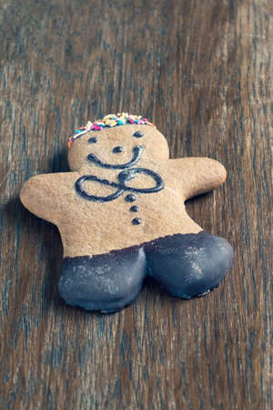 ginger bread man on a wooden table