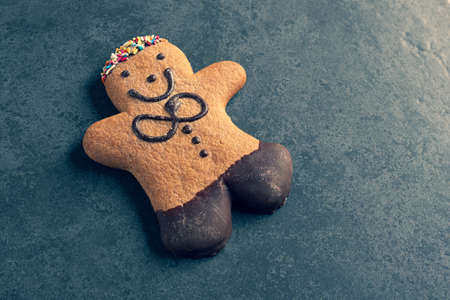 ginger bread man on a dark slate background Stockfoto