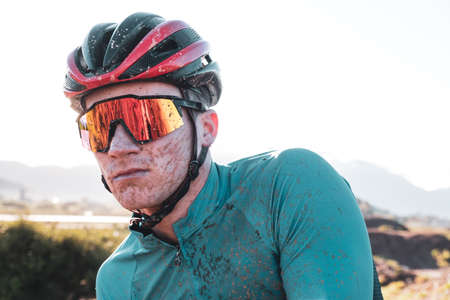 vibrant portrait of a dirty mountain biker