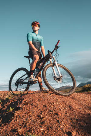 mountain biker portrait on top of a dirt bank