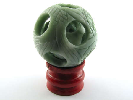 goodluck: A chinese dragonball made from expensive green jade on a red wood standing Stock Photo