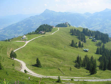 A landscape showing a mountain with green grass and trees Stock Photo - 766040