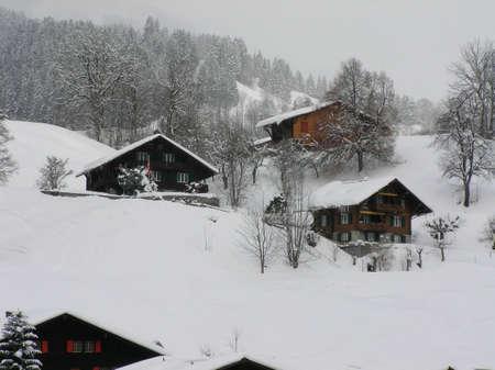 Beautiful winter landscape with a snowy village in Switzerland