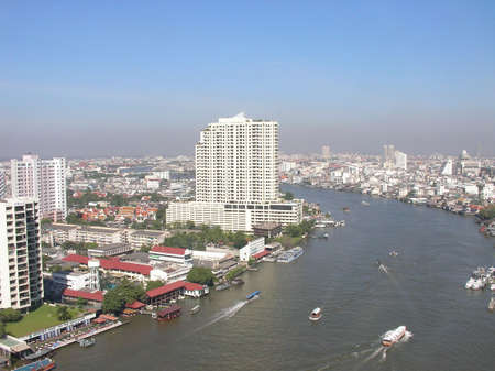 The skyline of Bangkok in Thailand with the big river flowing through it