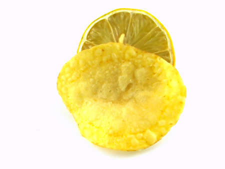 gease: A potato chip and lemon isolated on white Stock Photo