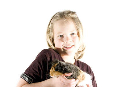 A girl and her guinea pig having fun in front of the camera