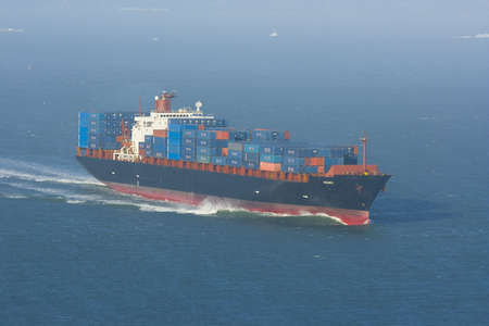 Containership with containers leaving the harbor