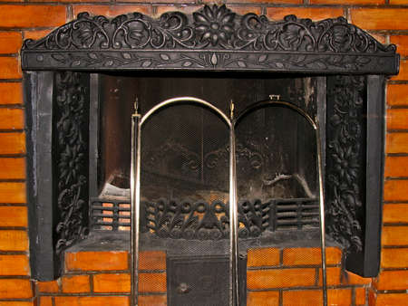 metal grate: Metal fireplace with an iron grate in masonry Stock Photo