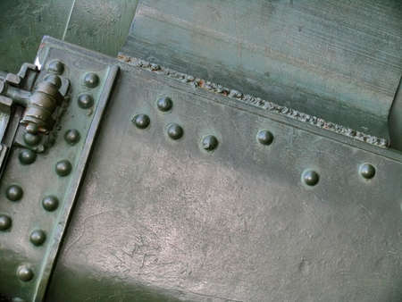 welds: Metallic texture with elements of rivets, welds and abrasions on surface