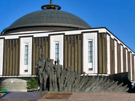 tragedy: Sculptural composition -Tragedy of Peoples- against building of Museum Great Patriotic war, July 26, 2014, Victory Park on Poklonnaya hill, Moscow, Russia