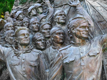 triumphant: Bas-relief, depicting faces of triumphant soldiers at moment of announcement of German surrender, Memory Alley, July 26, 2014, Victory Park on Poklonnaya hill, Moscow, Russia Editorial