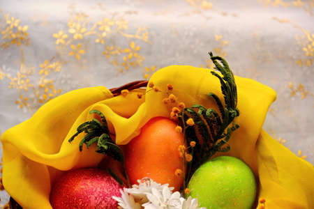 pearly: Easter eggs in basket, painted in different colors with pearly shimmer. Shallow depth of field Stock Photo