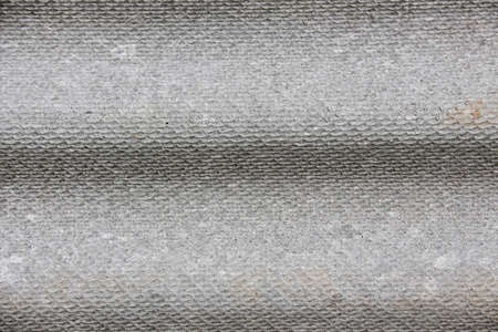 Texture of plywood with horizontal fluting in grey colors