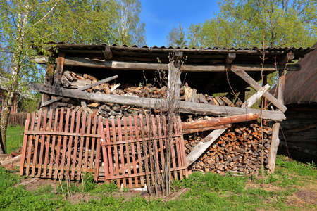 outbuilding: The rustic woodpile with harvested firewood outdoors Stock Photo