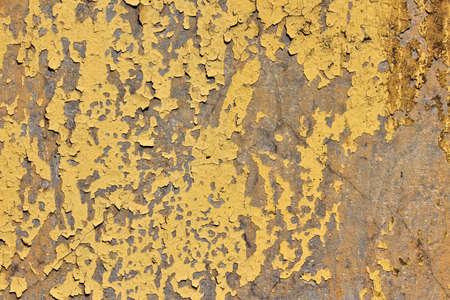 mangy: Concrete wall with peeling yellow paint. Horizontal orientation Stock Photo