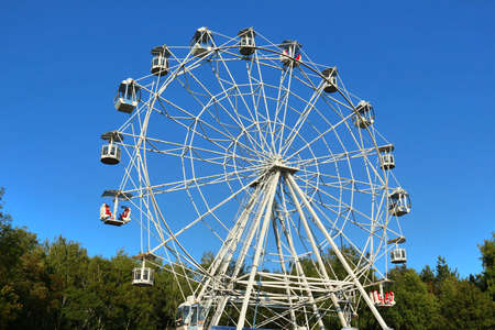 clear day: Ferris wheel against bright blue sky on clear day. Full view